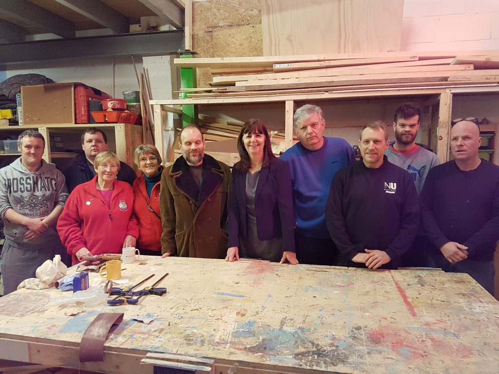 Lesley Griffiths AM with NuLife volunteers in the workshop.